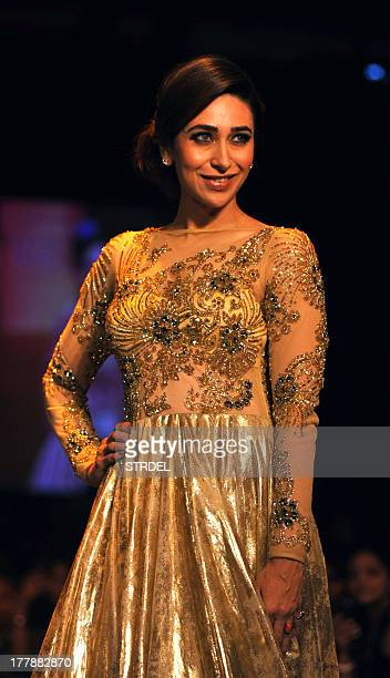 Indian Bollywood actress Karishma Kapoor showcases a creation by designer Vikram Phadnis during the Lakme Fashion Week Winter/Festival 2013 in Mumbai...