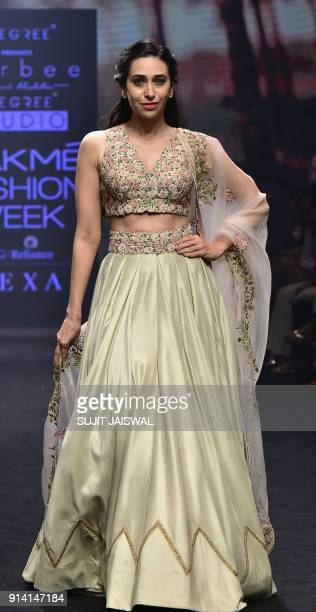 Indian Bollywood actress Karishma Kapoor showcases a creation by designer Ravi Bhalotia at the Lakmé Fashion Week Summer Resort 2018 in Mumbai on...