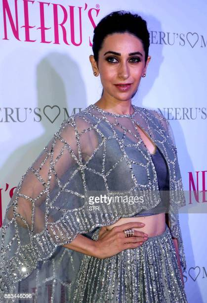 Indian Bollywood actress Karisma Kapoor poses during the launch of Neeru's store in Mumbai on November 30 2017 / AFP PHOTO / STR