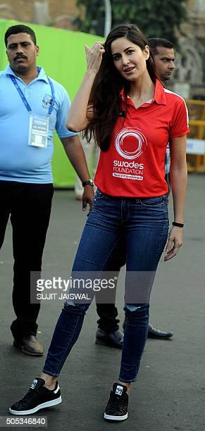 Indian Bollywood actress Katrina Kaif gestures at the 2016 Mumbai Marathon in Mumbai on January 17 2016 Thousands of people turned out on a cool...