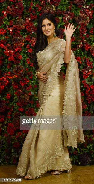 Indian Bollywood actress Katrina Kaif poses for a picture during the wedding reception party of actors Ranveer Singh and Deepika Padukone in Mumbai...