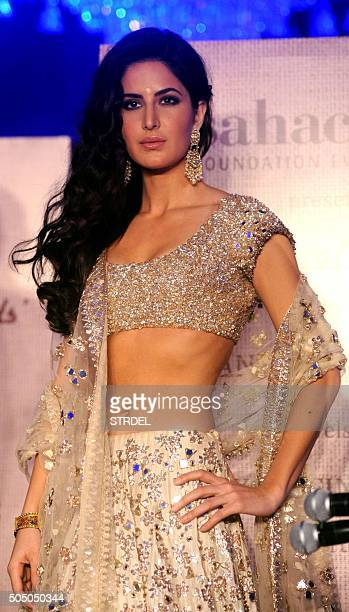 Indian Bollywood actress Katrina Kaif showcases a creation by Manish Malhotra during the 'Regal Threads' charity fashion show in Mumbai on late...