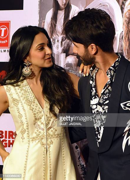 Indian Bollywood actress Kiara Advani and actor Shahid Kapoor look at eachother as they pose for photographs during the trailer launch of the...