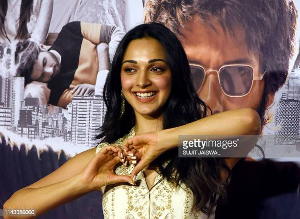 Indian Bollywood actress Kiara Advani gestures as she poses for photographs during the trailer launch of the upcoming Hindi film 'Kabir Singh' in...
