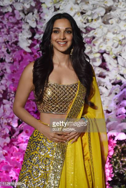 Indian Bollywood actress Kiara Advani poses for photographs as she arrives to attend the wedding reception of Akash Ambani son of Indian businessman...
