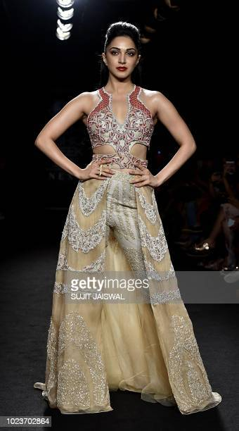Indian Bollywood actress Kiara Advani showcases a creation by designer Neha Agarwal at the Lakmé Fashion Week Winter Festive 2018 in Mumbai on August...