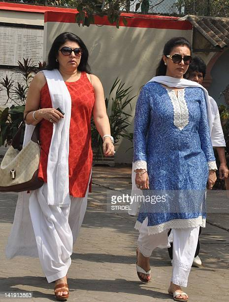 Indian Bollywood actress Kiran Juneja and Poonam Dhillon attend the funeral of producer Mona Kapoor in Mumbai on March 26 2012 AFP PHOTO/STR