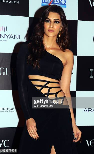Indian Bollywood actress Kriti Sanon poses for a photo during the 10th edition of the 'Vogue Women of the Year Awards' event in Mumbai on September...