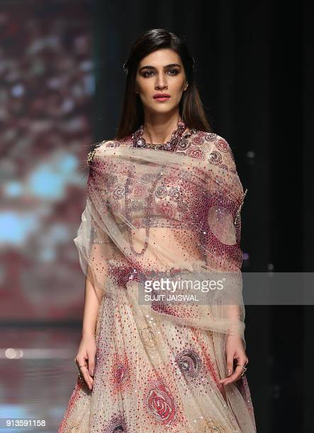Indian Bollywood actress Kriti Sanon showcases a creation by designer Tarun Tahiliani at the Lakmé Fashion Week Summer Resort 2018 in Mumbai on...