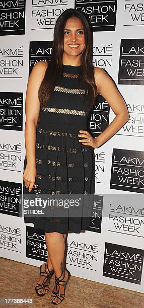 Indian Bollywood actress Lara Dutta attends the Lakme Fashion Week Winter/Festival 2013 in Mumbai on August 22 2013 AFP PHOTO/STR
