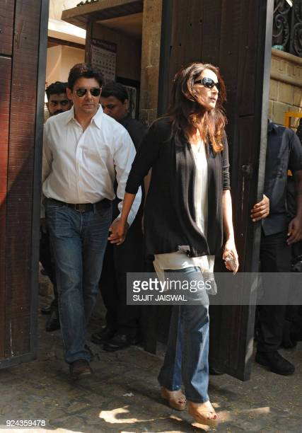 Indian Bollywood actress Madhuri Dixit arrives with her husband at the residence of relative Anil Kapoor following the death of the actress Sridevi...