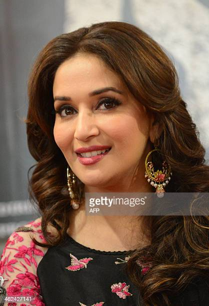 Indian Bollywood actress Madhuri Dixit looks on during a promotional event for the forthcoming film 'Dedh Ishqiya' in Ahmedabad on January 13 2014...