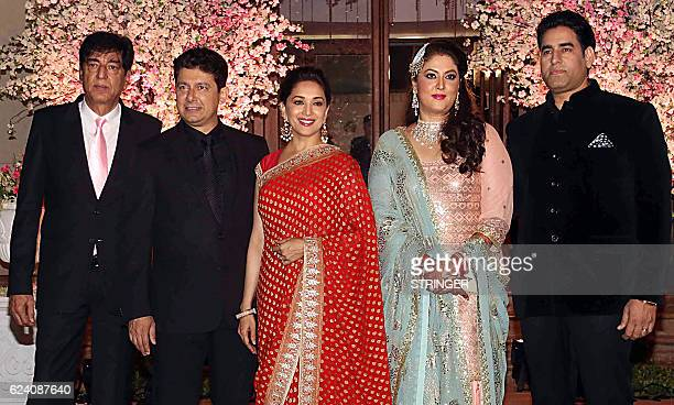 Indian Bollywood actress Madhuri Dixit Nene and her husband attend the wedding reception of Shaina Nath the daughter of producer and star secretary...