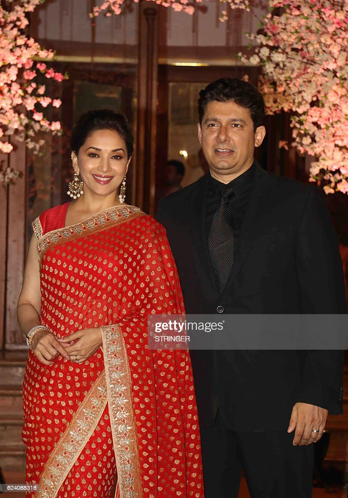 Indian Bollywood Actress Madhuri Dixit Nene L And Her Husband Attend The Wedding Reception