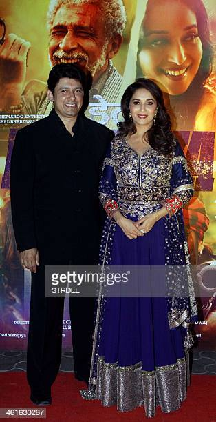 Indian Bollywood actress Madhuri Dixit Nene and her husband Dr Sriram Nene pose for a photograph at the premiere of the Hindi film Dedh Ishqiya in...