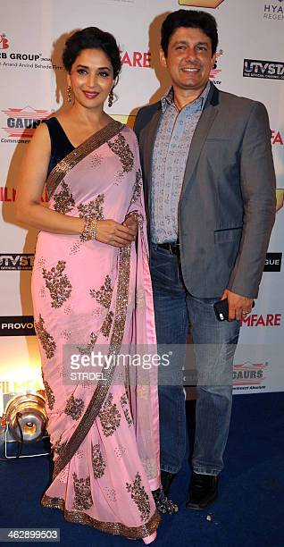 Indian Bollywood actress Madhuri Dixit Nene and her husband pose for a photograph during the 59th Idea Filmfare Awards 2013 preawards party in Mumbai...