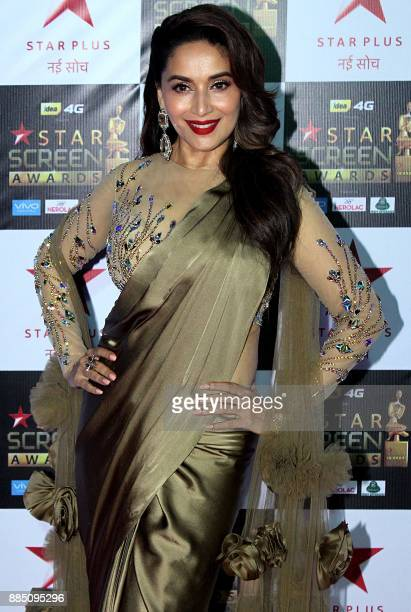 Indian Bollywood actress Madhuri Dixit Nene attends the 'Star Screen Awards 2017' ceremony in Mumbai on December 3 2017 / AFP PHOTO /
