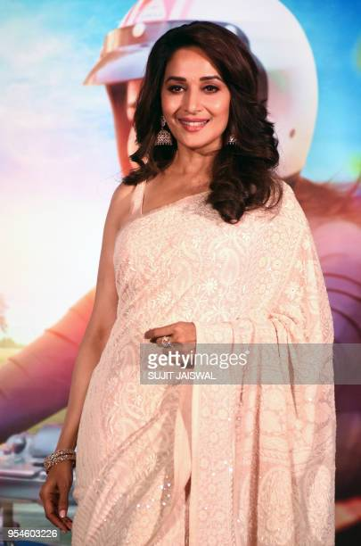 Indian Bollywood actress Madhuri Dixit poses for photograph during a promotional event for the forthcoming Marathi movie 'Bucket List' directed by...