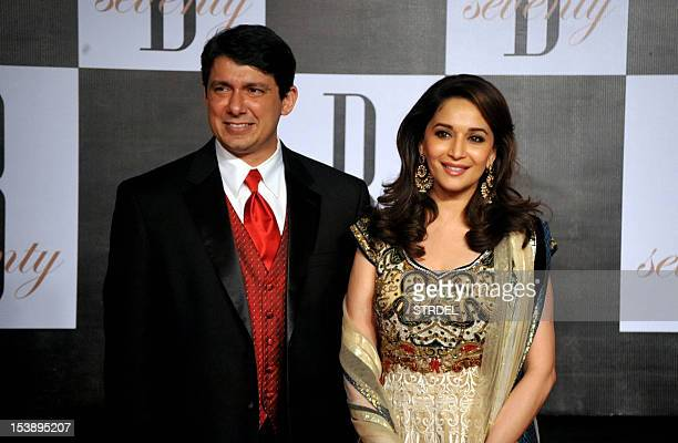 Indian Bollywood actress Madhuri Dixit poses with her husband Shriram Nene as they attend the 70th Birthday celebrations of Bollywood Actor Amitabh...