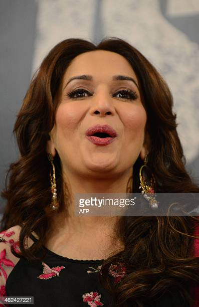 Indian Bollywood actress Madhuri Dixit reacts during a promotional event for the forthcoming film 'Dedh Ishqiya' in Ahmedabad on January 13 2014 AFP...