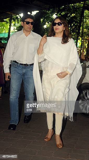Indian Bollywood actress Madhuri Dixit with her husband attends a prayer meeting for the late Bollywood music composer and singer Aadesh Shrivastava...