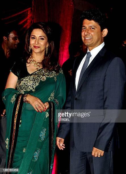 Indian Bollywood actress Madhuri Dixit with husband Shriram Madhav Nene attend the wedding reception of actors Ritesh Deshmukh and Genelia D'Souza in...