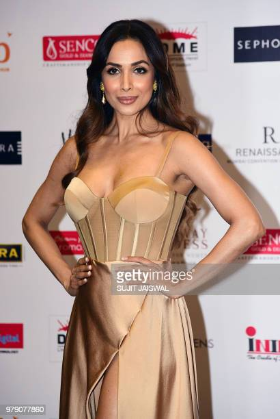 Indian Bollywood actress Malaika Arora poses for a picture during the grand finale of the 'Femina Miss India 2018' event in Mumbai late on June 19...