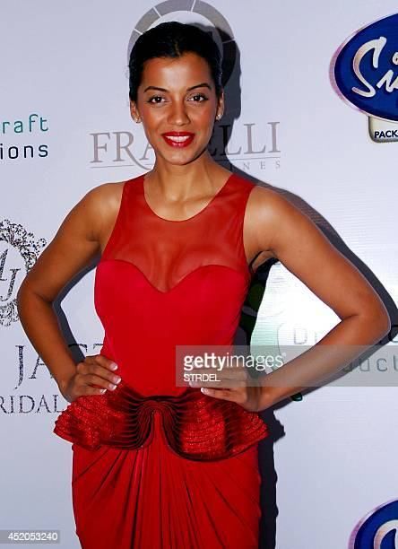 Indian Bollywood actress Mugdha Godse poses for a photograph during the launch of a fashion line in Mumbai on late July 11 2014 AFP PHOTO / STR