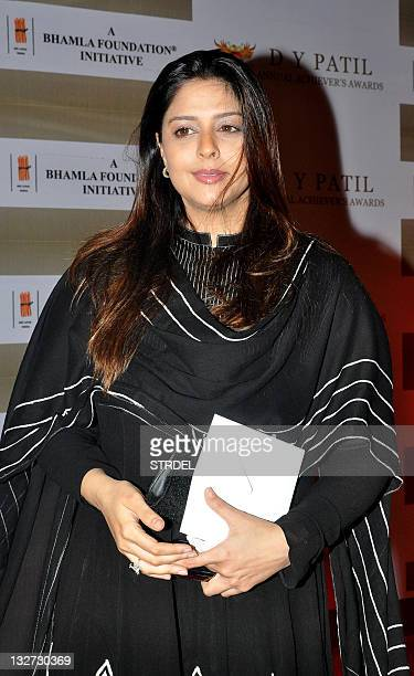 Indian Bollywood actress Nagma poses as she arrives at the first D Y Patil Annual 'Achiever's Awards' ceremony in Mumbai on November 13 2011 The...