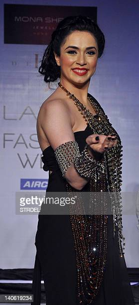 Indian Bollywood actress Nargis Bagheri displays creation by designer Mona Shroff during the second day of Lakme Fashion Week summer resort 2012 in...