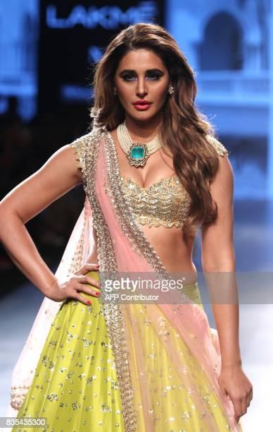 Indian Bollywood actress Nargis Fakhri showcases a creation by designer Anushree Reddy at Lakme Fashion Week Winter/Festive 2017 in Mumbai on August...