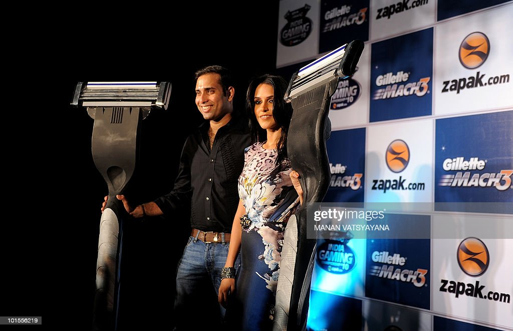 Indian Bollywood actress Neha Dhupia (R) and cricketer VVS Laxman (L) pose during the launch of an online gaming championship in New Delhi on June 2, 2010. Gillette in partnership with India's largest online gaming website Zapak.com announced the Indian Gaming Championship to be held in 34 cities and with prizes worth INR 15 million.