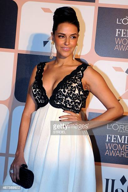Indian Bollywood actress Neha Dhupia poses as she attends LOreal Paris Femina Women Awards 2015 ceremony in Mumbai late March 23 2015 AFP PHOTO/STR
