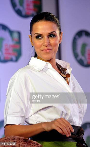 Indian Bollywood actress Neha Dhupia poses for a photograph during a promotional event in Mumbai on January 8 2015 AFP PHOTO / STR