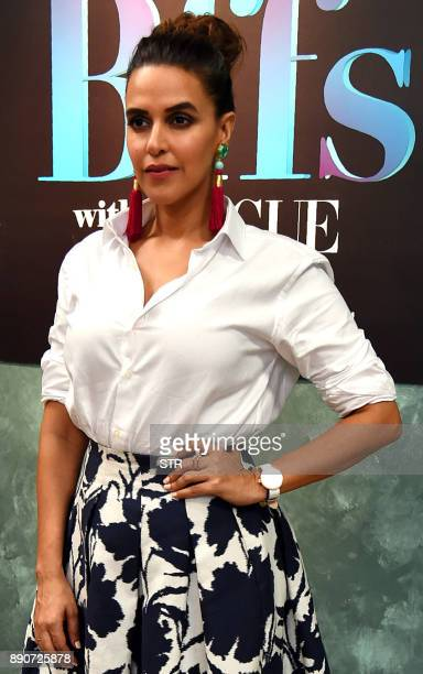 Indian Bollywood actress Neha Dhupia poses for a photograph during a promotional event in Mumbai on December 11 2017 / AFP PHOTO / STR