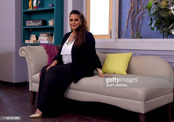 Indian Bollywood actress Neha Dhupia poses for photographs during a shooting of the reality talk show 'Vogue BFFs' season 3 in Mumbai on April 11,...