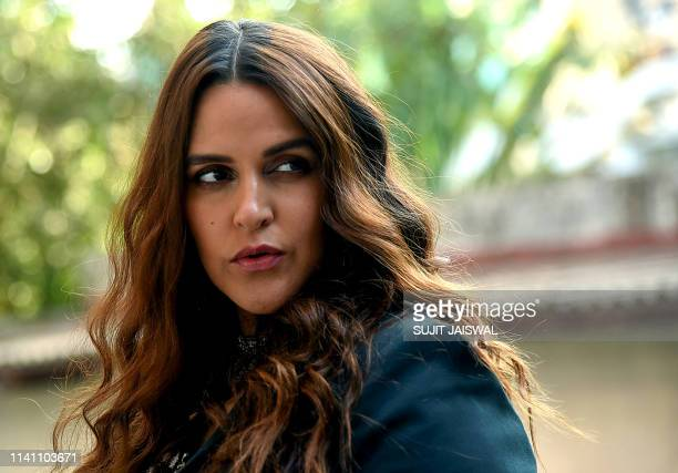 """Indian Bollywood actress Neha Dhupia poses for photographs during the recording of the reality talk show """"Vogue BFFs"""" season 3, in Mumbai on May 4,..."""