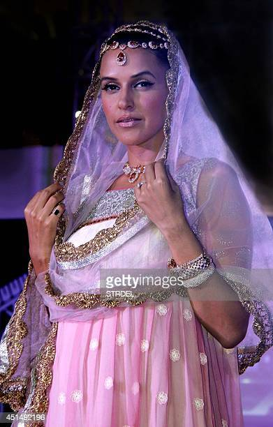 Indian Bollywood actress Neha Dhupia showcases a creation during the 'Indian Wedding Couture' fashion show in Mumbai on late June 29 2014 AFP...