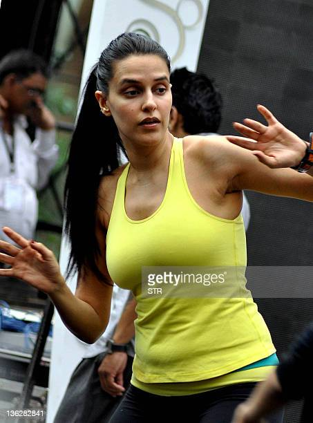 Indian Bollywood actress Neha Dhupia takes part in a dance practice session in Mumbai late December 30 ahead of a New Year's Eve performance AFP...