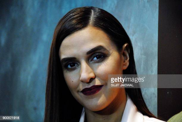 Indian Bollywood actress Neha Dhupia the host for the Colors Infinity TV Serial Vogue BFFs looks on while on set in Mumbai on January 2 2018