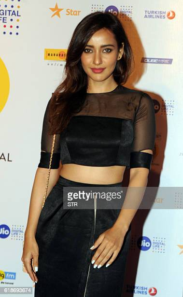 Indian Bollywood actress Neha Sharma poses for a photograph at the closing ceremony of the 18th Mumbai Film Festival in Mumbai on late October 27...