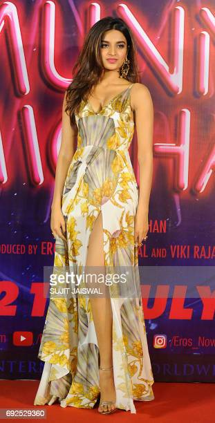 Indian Bollywood actress Nidhhi Agarwal poses for a photograph during a promotional event for the forthcoming Hindi film Munna Michael directed by...