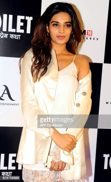 Indian Bollywood actress Nidhhi Agerwal poses for a photograph during a screening of Hindi film 'Toilet Ek Prem Katha' in Mumbai on August 10 2017 /...
