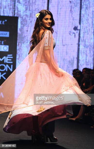 Indian Bollywood actress Nidhhi Agerwal showcases a creation by designer Suloka Sudhakar at the Lakmé Fashion Week Summer Resort 2018 in Mumbai on...