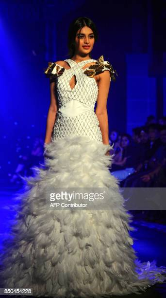Indian Bollywood actress Nidhhi Agerwal showcases a creation by designer Ezra Tuba during the Tech Fashion Tour Season 3 in Mumbai on late September...