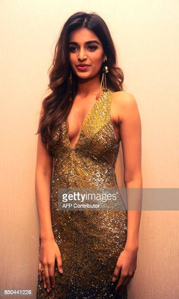 Indian Bollywood actress Nidhhi Agerwal showcases a creation by designer Rajat K Tangri during the Tech Fashion Tour Season 3 in Mumbai on late...