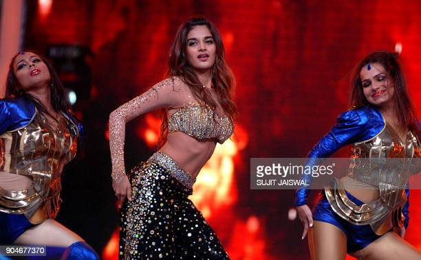Indian Bollywood actress Nidhhi Agerwal takes part in the'Umang Mumbai Police Show 2018' in Mumbai on late January 13 2018 / AFP PHOTO / Sujit Jaiswal