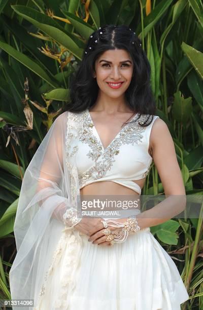 Indian Bollywood actress Nimrat Kaur poses for a photograph at Lakmé Fashion Week Summer Resort 2018 in Mumbai on February 2 2018 / AFP PHOTO / Sujit...