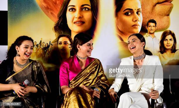 Indian Bollywood actress Nithya Menen Kirti Kulhari and Taapsee Pannu attend the trailer launch of the upcoming Hindi drama film 'Mission Mangal' in...