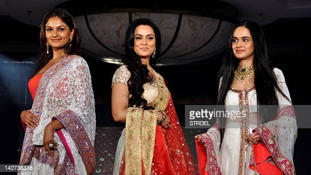 Indian Bollywood actress Padmini Kolhapure and her sister Tejaswini Kolhapure and Shivangi Kapoor display creations by designer Manish Malhotra for a...